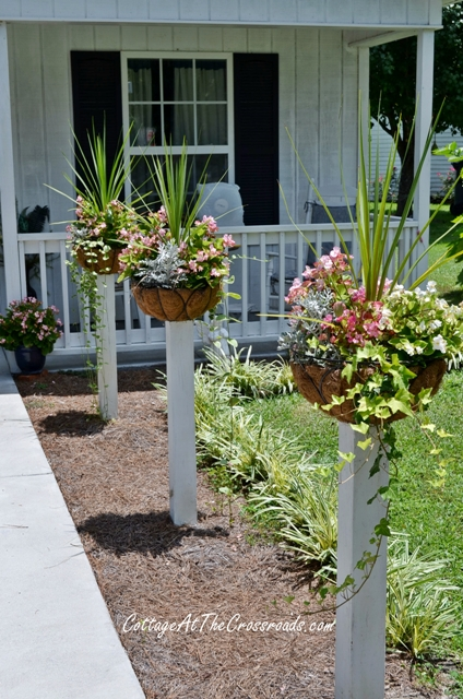 Flower baskets on posts