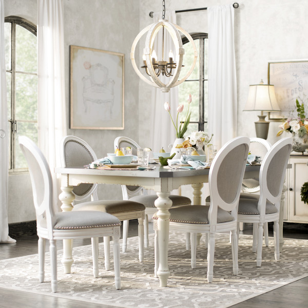 Gorgeous dining room with tons of light. Lots of other great dining room inspiration here, too!