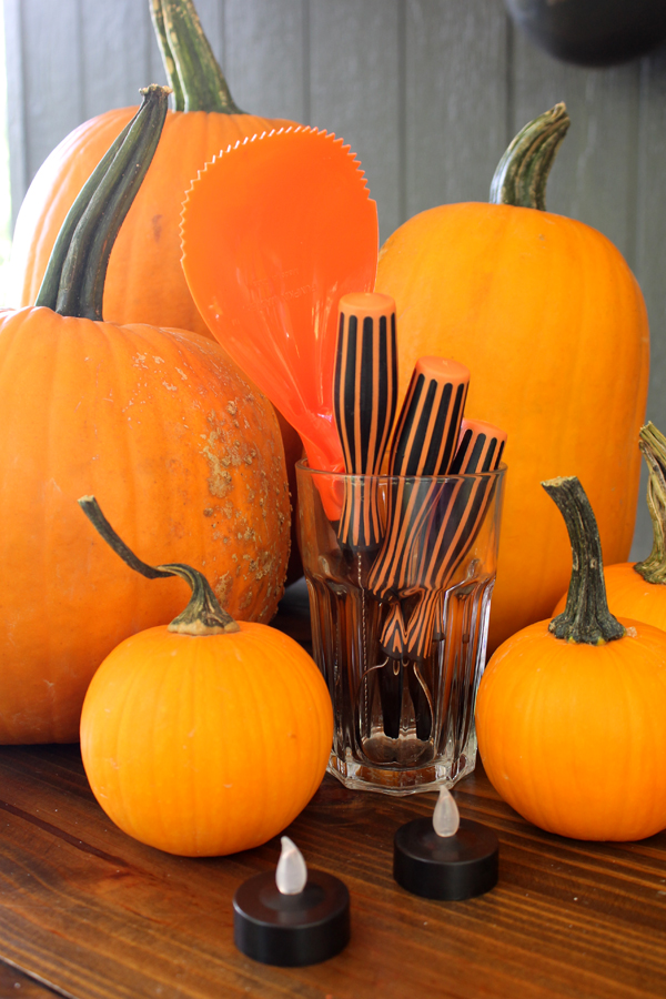 Pumpkin carving party ideas - host the best party of the Halloween season with these great tips!