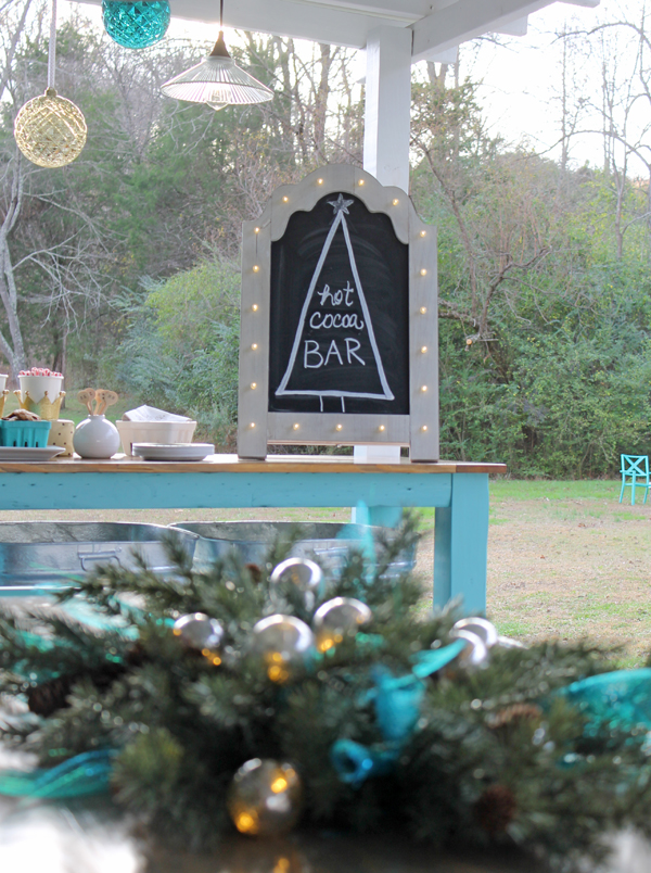 Beautiful ideas for outdoor Christmas decorating - complete with a hot chocolate bar. Such a fun way to add some Christmas touches to an outdoor space!