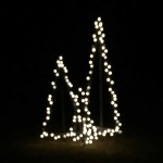 An easy way to DIY outdoor lighted Christmas trees. Free tutorial to show how step by step - cheap and beautiful!