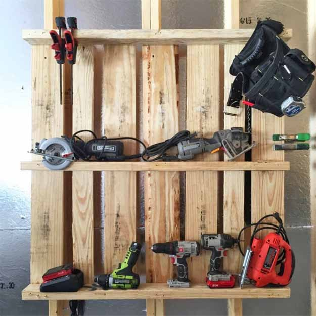 Great idea for organizing drills, etc. in the garage -  made in just a few minutes from a pallet!
