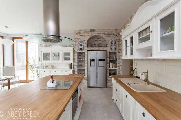 love the brick on the back wall of this gorgeous kitchen