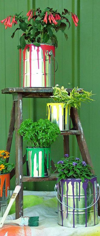 Love these creative garden ideas - these paint can planters are awesome!