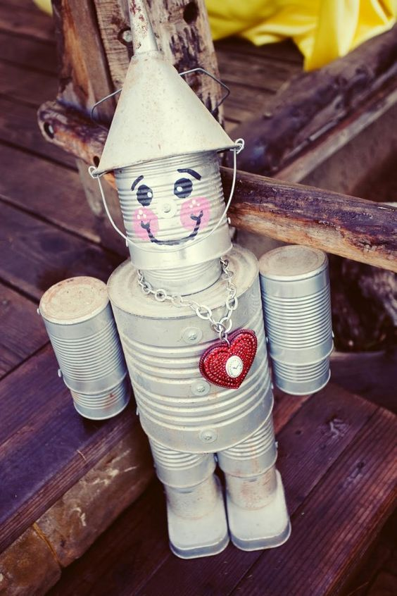 What a unique garden art idea: a sweet little tin man!