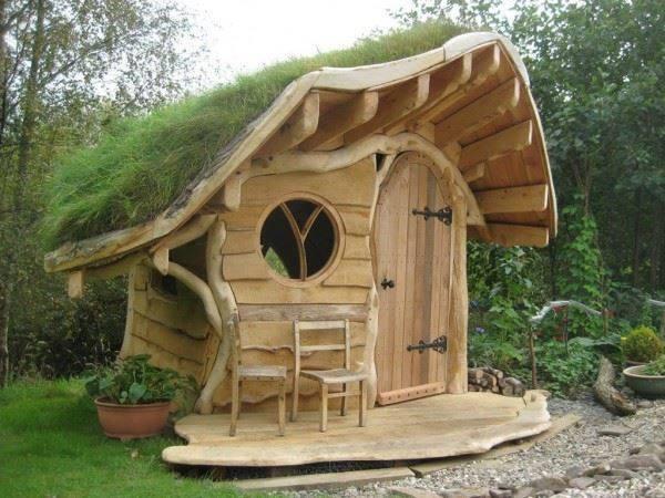 what a pretty little backyard garden shed!