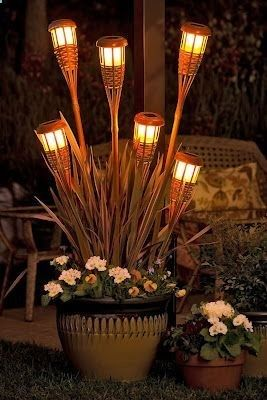 So many awesome garden ideas - I love these lights made from tiki torches!