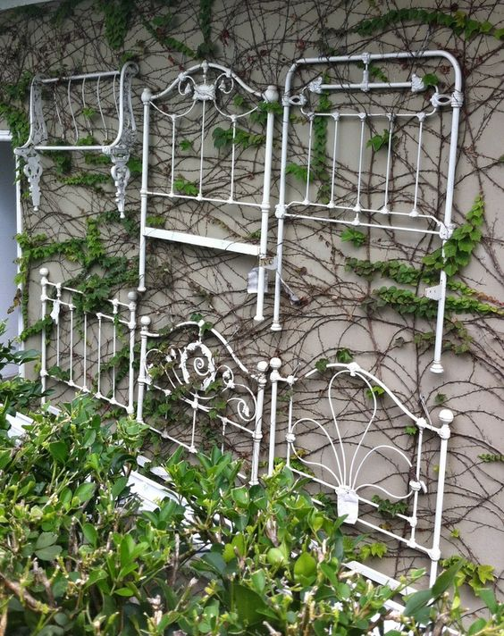 Upcycle several old headboards into a trellis wall