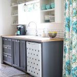 This aqua kitchen is SO pretty! Tons of great ideas - and she's got an entire aqua kitchen collection. I want one of every single thing!