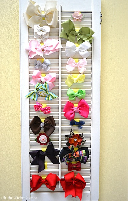 Such a fun idea - use an old shutter to organize hair bows!
