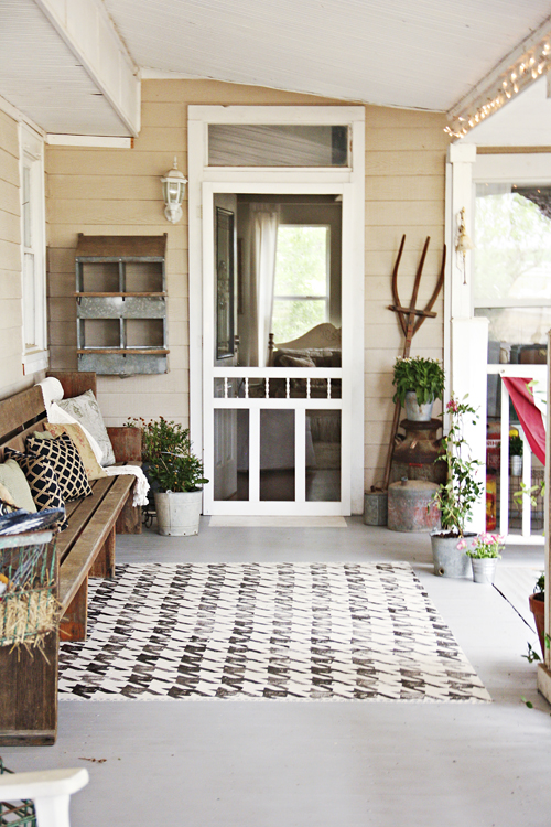 Fun ideas for repurposed farm equipment for all kinds of decorating. Lovely porch with nesting boxes!