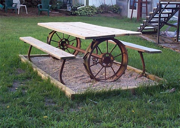Picnic table made from repurposed farm equipment. Tons of great ideas in this post!