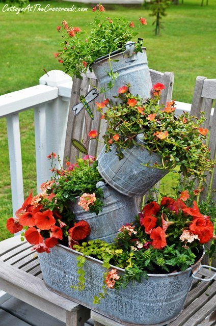 Fun topsy turvy planter made from repurposed farm equipment. Tons of great ideas in this post!