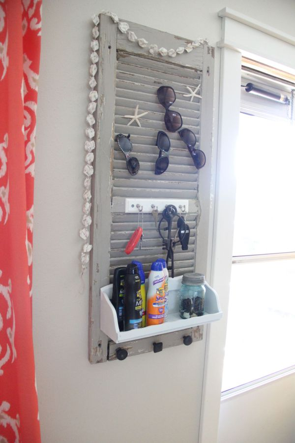 Use an old shutter to keep your summer gear together