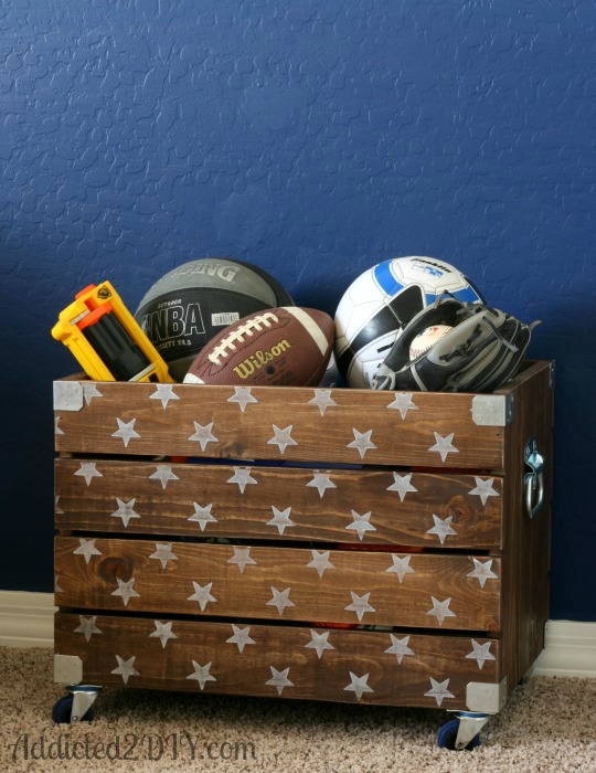 Wood crates make awesome toy boxes like this one on Addicted 2 DIY .