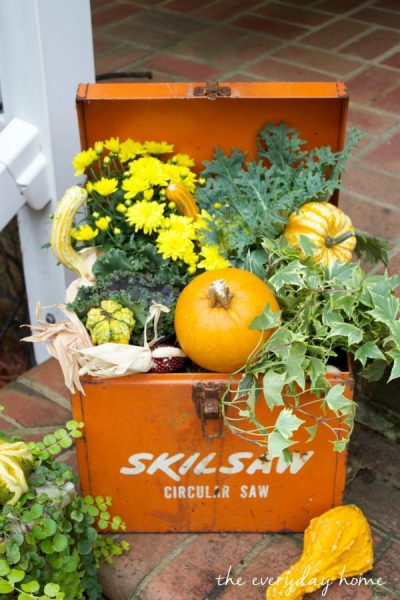 love this fall porch decorating idea - she made a fall planter from a vintage tool box