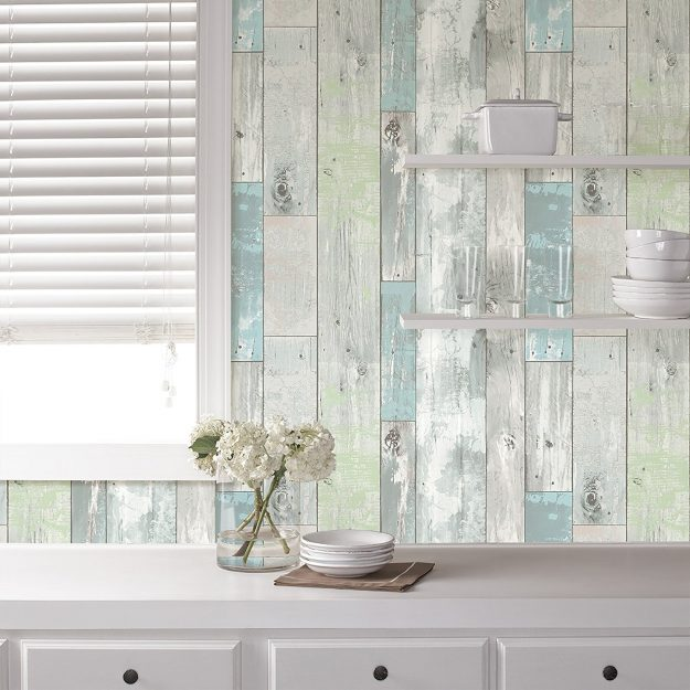 How to Update Your Kitchen on a Budget - this backsplash is WALLPAPER - so pretty!
