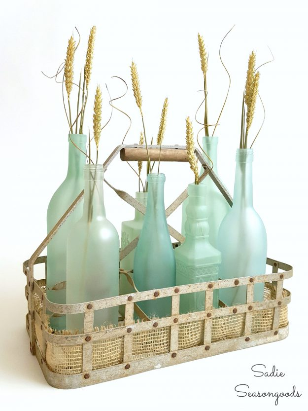 farmhouse decor from the dollar store - paint soda bottles for a pretty centerpiece