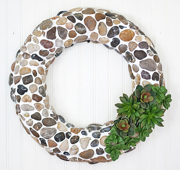 Farmhouse decor from the dollar store -- make this wreath with rocks from the craft section