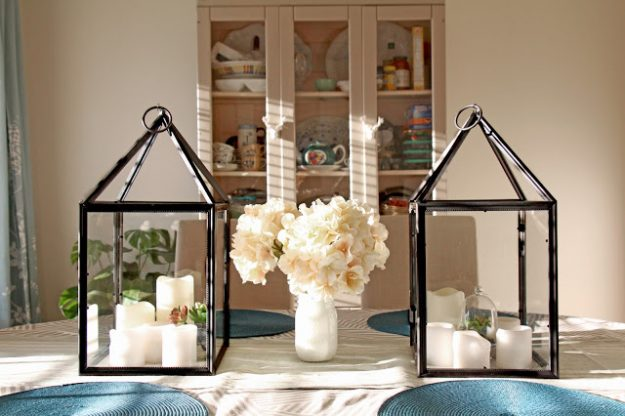 Great ideas for making farmhouse decor from dollar store items - these lanterns were made from photo frames!